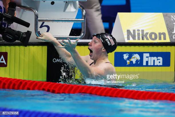 Lilly Ling of United States reacts as she breaks the world record during the Women's 100m Breaststroke final during day twelve of the FINA World...