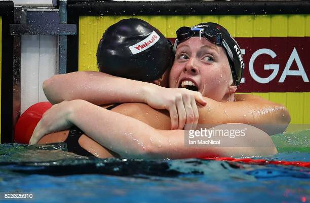 Lilly Ling of United States reacts with Katie Meili as she breaks the world record during the Women's 100m Breaststroke final during day twelve of...