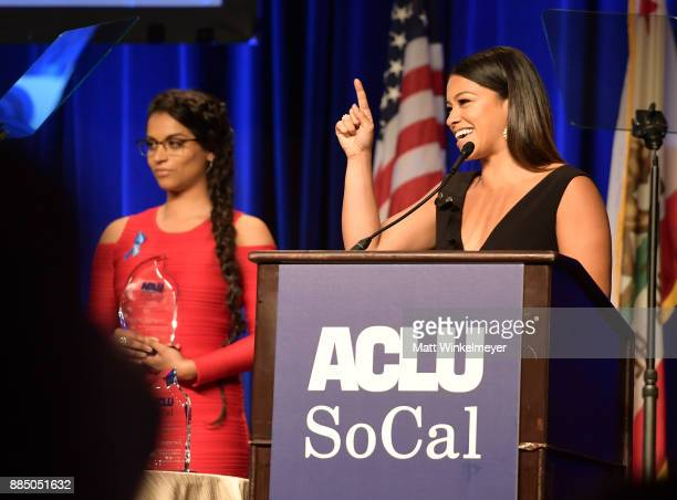 Lilly Singh and honoree Gina Rodriguez speak onstage at ACLU SoCal Hosts Annual Bill of Rights Dinner at the Beverly Wilshire Four Seasons Hotel on...