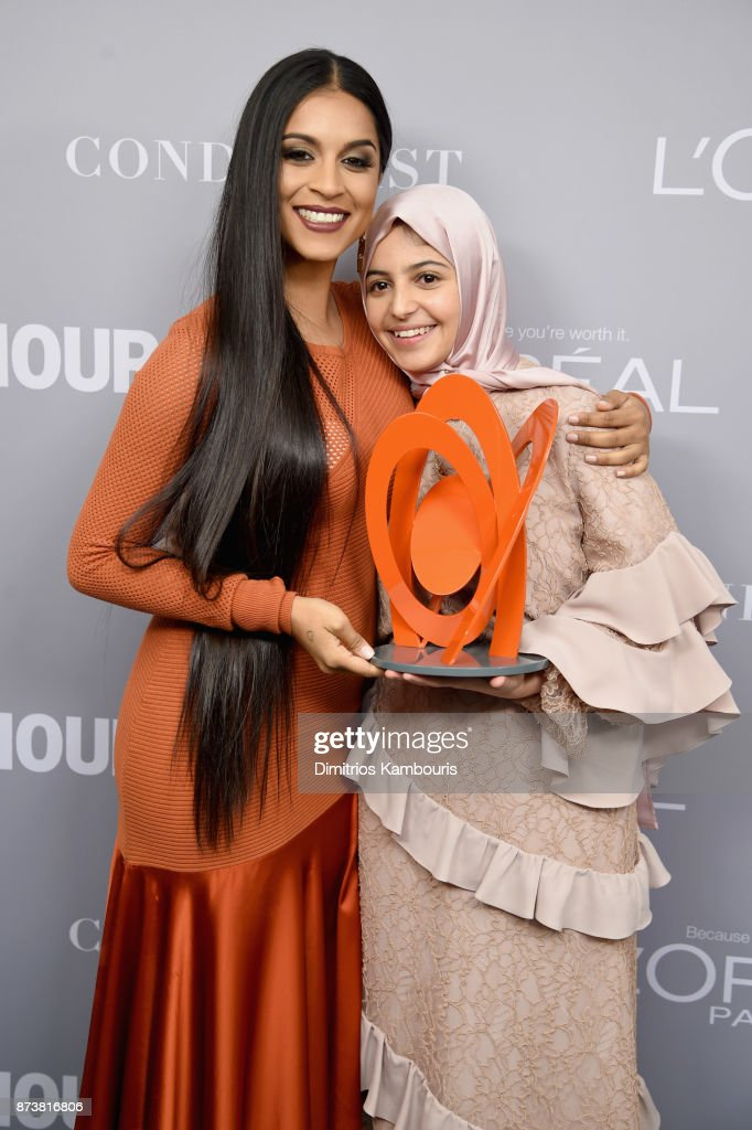 Lilly Singh and Muzoon Almellehan pose with an award backstage at the Glamour's 2017 Women of The Year Awards at Kings Theatre on November 13, 2017 in Brooklyn, New York.