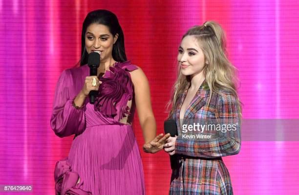 Lilly Singh and Sabrina Carpenter speak onstage during the 2017 American Music Awards at Microsoft Theater on November 19 2017 in Los Angeles...