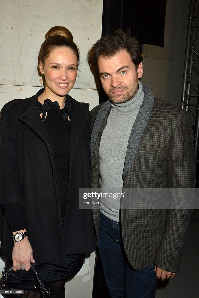 Lilou Fogli and Clovis Cornillac attend the Alexis Mabille- Front Row - PFW F/W 2013 at Palais de Tokyo on February 27, 2013 in Paris, France.