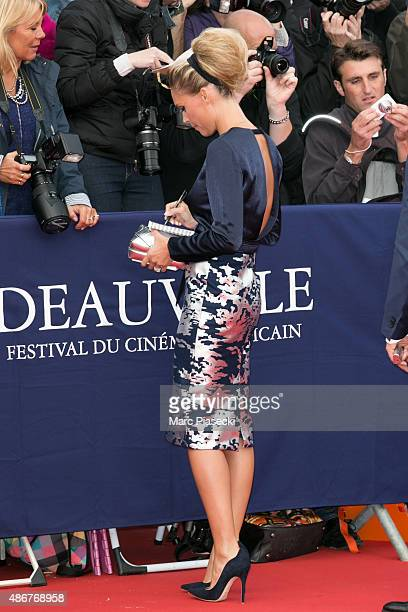 Lilou Fogli signs autographs as she attends the 41st Deauville American Film Festival Opening Ceremony on September 4 2015 in Deauville France