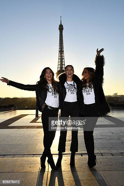 Lily Aldridge Adriana Lima and Jasmine Tookes pose in front of the Eiffel Tower prior the 2016 Victoria's Secret Fashion Show on November 29 2016 in...