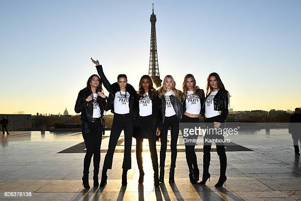 Lily Aldridge Adriana Lima Jasmine Tookes Elsa Hosk Josephine Skriver and Alessandra Ambrosio pose in front of the Eiffel Tower prior the 2016...