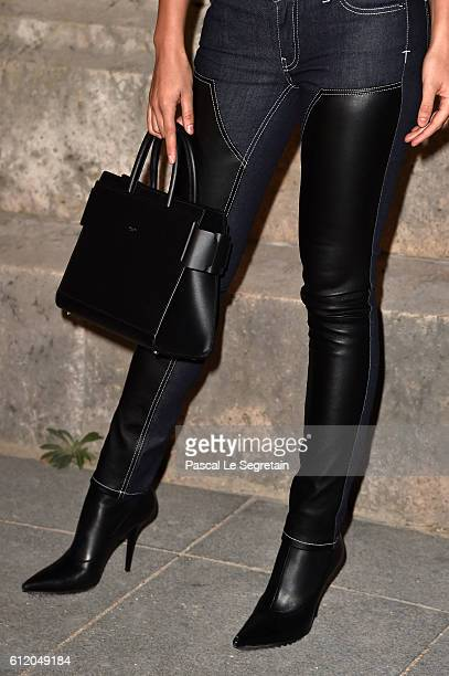 Lily Aldridgebag detail attends the Givenchy show as part of the Paris Fashion Week Womenswear Spring/Summer 2017 on October 2 2016 in Paris France