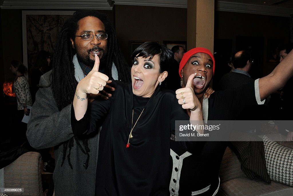 <a gi-track='captionPersonalityLinkClicked' href=/galleries/search?phrase=Lily+Allen&family=editorial&specificpeople=724899 ng-click='$event.stopPropagation()'>Lily Allen</a> (C) and guests attend a private screening of 'Saving Mr. Banks' which she hosted at the Charlotte Street Hotel on November 18, 2013 in London, England.
