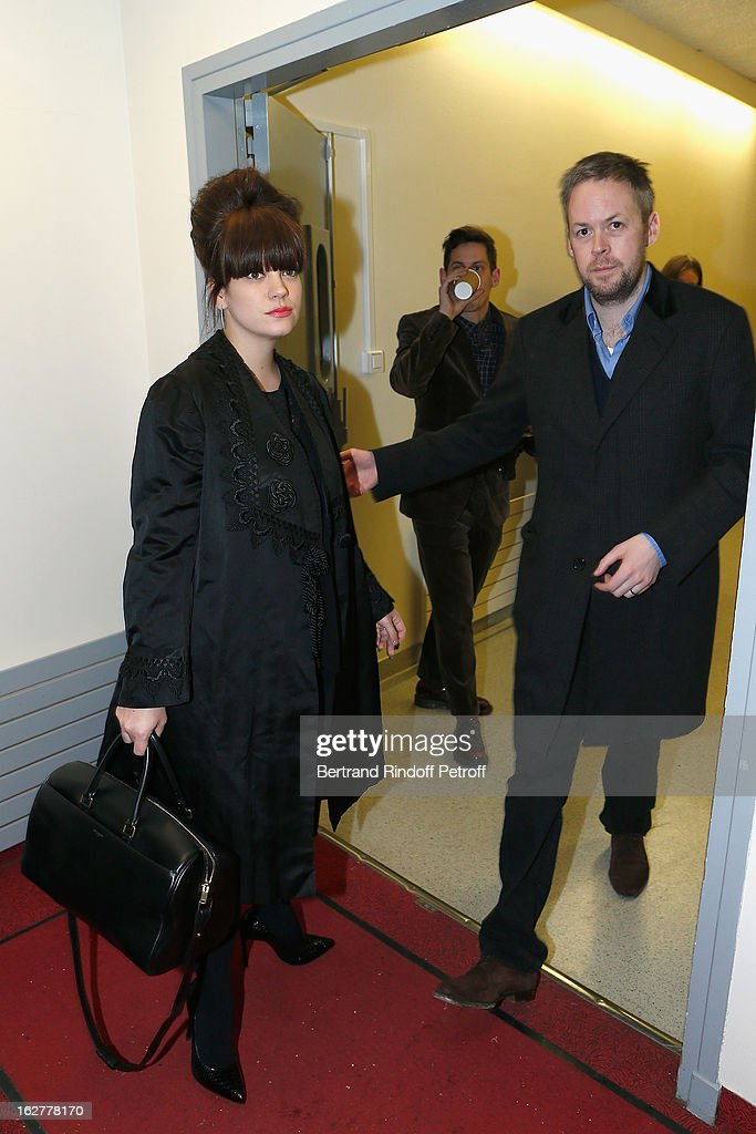 Lily Allen (L) and husband Sam Cooper pose backstage following the Etam Live Show Lingerie at Bourse du Commerce on February 26, 2013 in Paris, France.