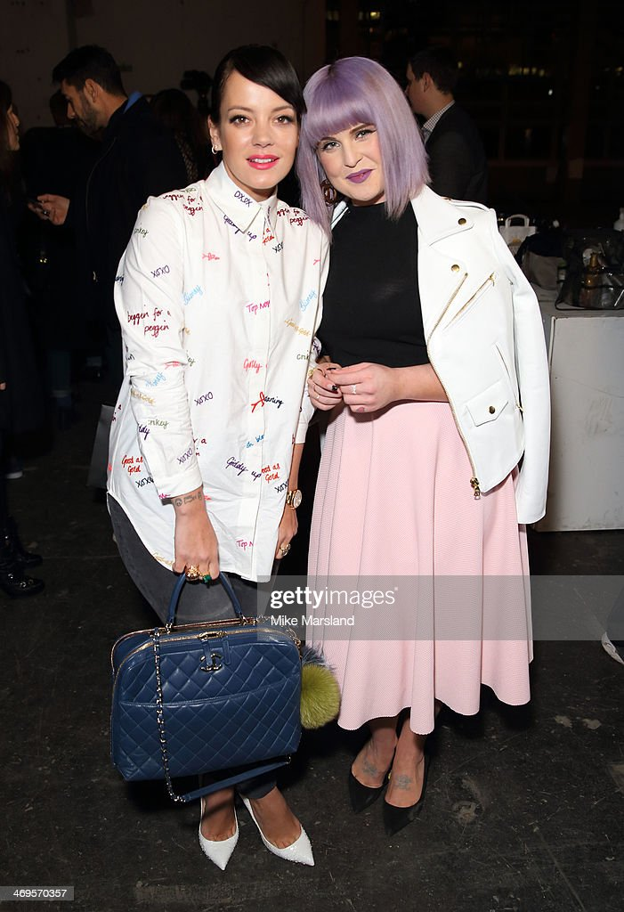 Lily Allen and Kelly Osbourne attend the House of Holland show at London Fashion Week AW14 at on February 15, 2014 in London, England.