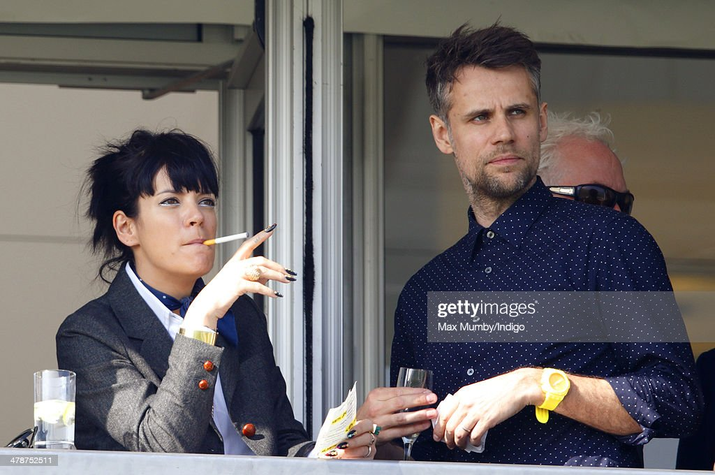 Lily Allen and Richard Bacon watch the racing as they attend Day 4 of the Cheltenham Festival at Cheltenham Racecourse on March 14, 2014 in Cheltenham, England.