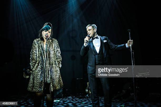 Lily Allen and Robbie Williams perform at the 'Under 1 Roof' concert in aid of Kids Company at Hammersmith Apollo on December 19 2013 in London...
