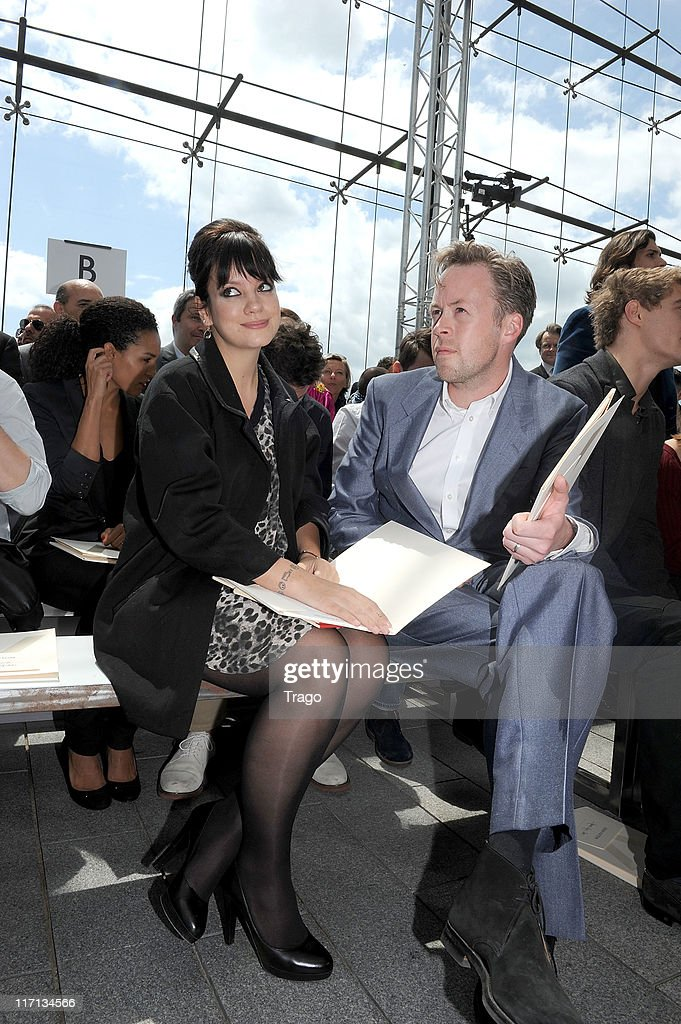 <a gi-track='captionPersonalityLinkClicked' href=/galleries/search?phrase=Lily+Allen&family=editorial&specificpeople=724899 ng-click='$event.stopPropagation()'>Lily Allen</a> and Sam Cooper attend the Louis Vuitton Menswear Spring/Summer 2012 show as part of Paris Fashion Week at Parc Andre Citroen on June 23, 2011 in Paris, France.