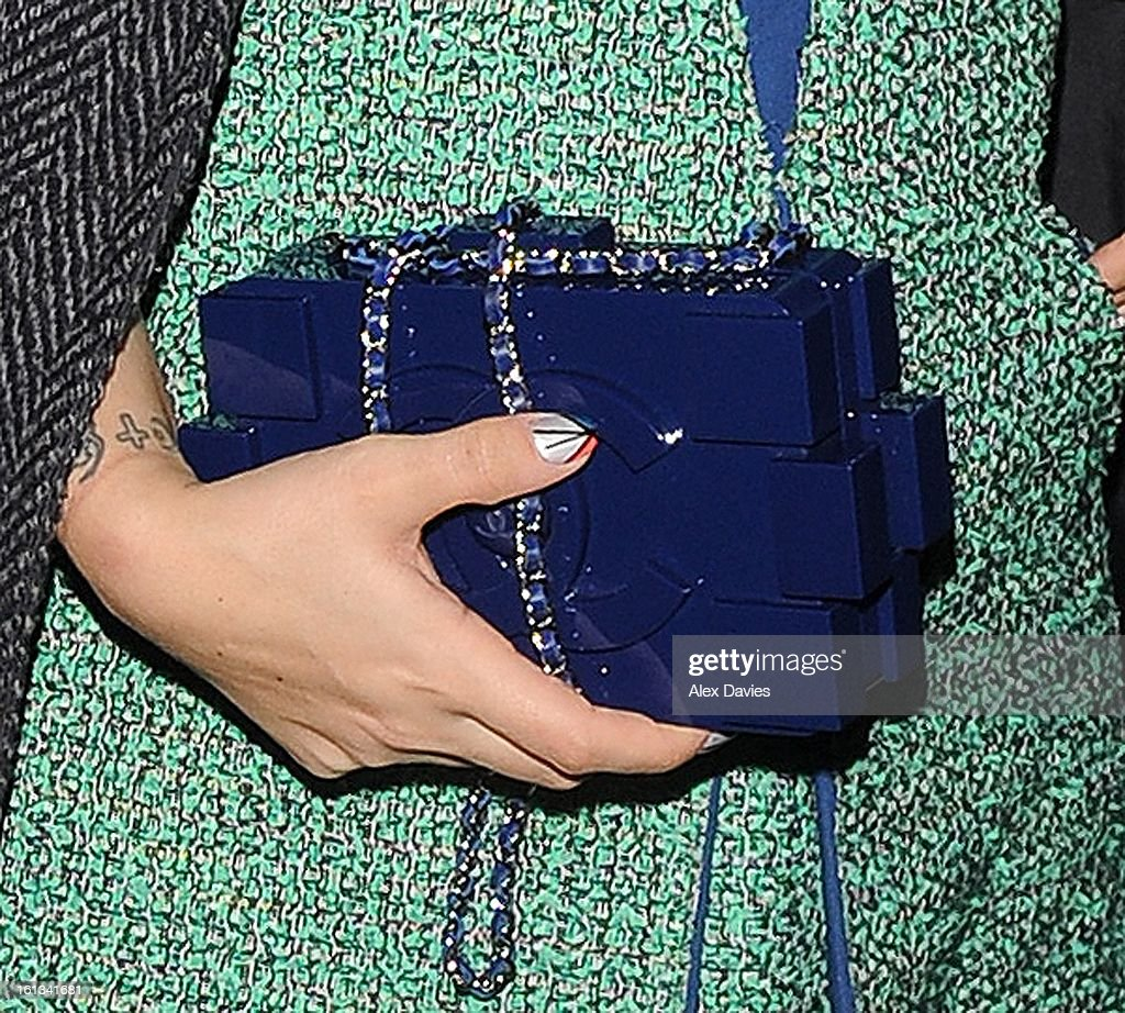 <a gi-track='captionPersonalityLinkClicked' href=/galleries/search?phrase=Lily+Allen&family=editorial&specificpeople=724899 ng-click='$event.stopPropagation()'>Lily Allen</a> (bag detail) attends Annabel's pre-BAFTA party on February 9, 2013 in London, England.