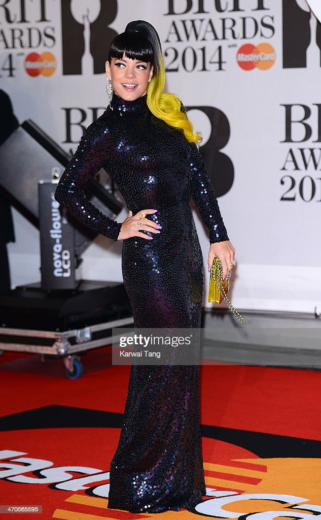 <a gi-track='captionPersonalityLinkClicked' href=/galleries/search?phrase=Lily+Allen&family=editorial&specificpeople=724899 ng-click='$event.stopPropagation()'>Lily Allen</a> attends The BRIT Awards 2014 at 02 Arena on February 19, 2014 in London, England.