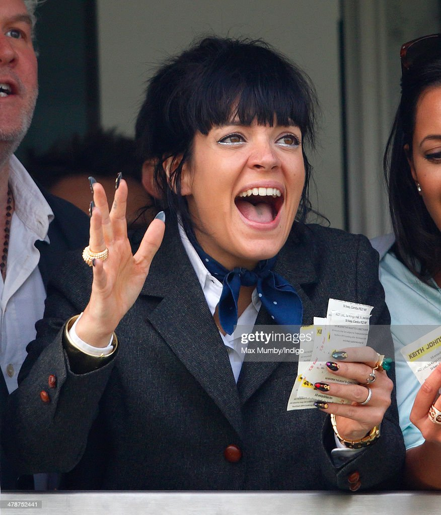 <a gi-track='captionPersonalityLinkClicked' href=/galleries/search?phrase=Lily+Allen&family=editorial&specificpeople=724899 ng-click='$event.stopPropagation()'>Lily Allen</a> cheers and celebrates as she watches the Cheltenham Gold Cup on Day 4 of the Cheltenham Festival at Cheltenham Racecourse on March 14, 2014 in Cheltenham, England.