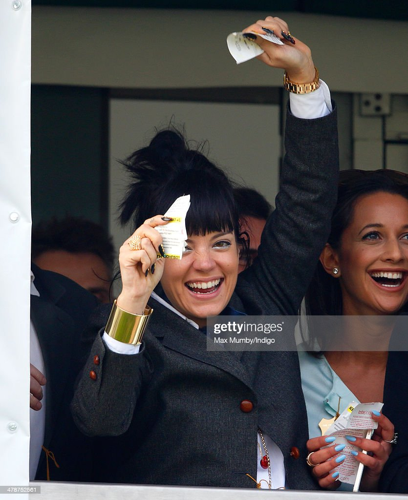 Lily Allen cheers and celebrates as she watches the Cheltenham Gold Cup on Day 4 of the Cheltenham Festival at Cheltenham Racecourse on March 14, 2014 in Cheltenham, England.
