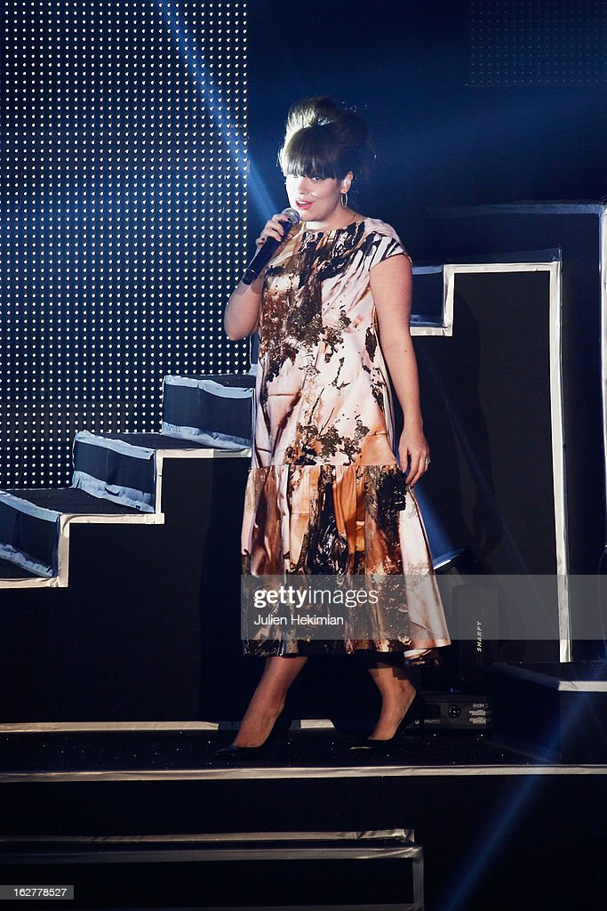 Lily Allen performs during the Etam Live Show Lingerie at Bourse du Commerce on February 26, 2013 in Paris, France.