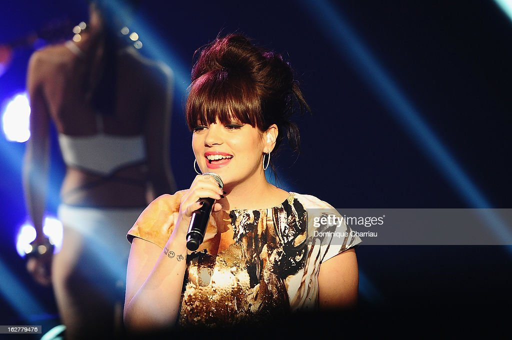Lily Allen performs live during the Etam Live Show Lingerie at Bourse du Commerce on February 26, 2013 in Paris, France.