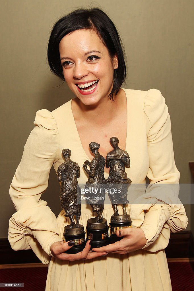 Lily Allen poses with her 3 awards in the press room at the 55th Ivor Novello Awards held at Grosvenor House Hotel on May 20, 2010 in London, England.