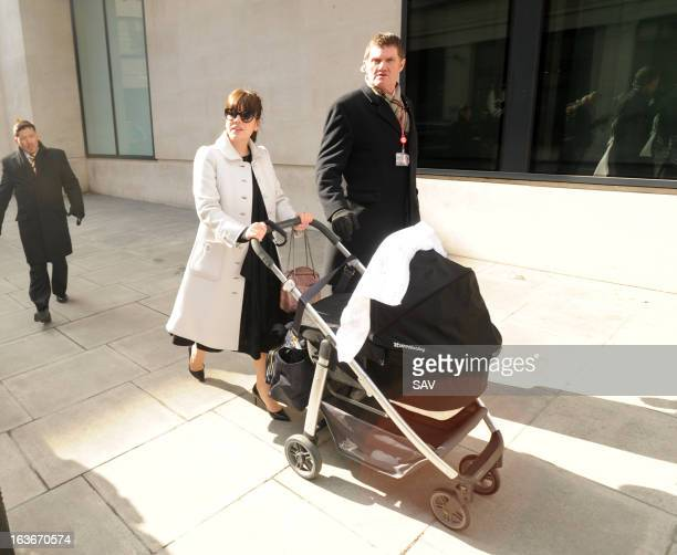 Lily Allen pushes her daughter Marnie Rose in a pram as she walks to Radio 1 for Comic Relief on March 14 2013 in London England