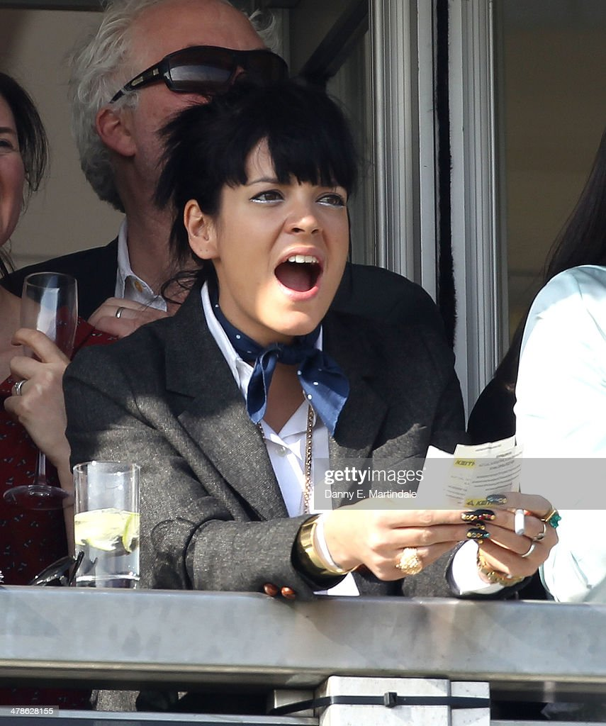 <a gi-track='captionPersonalityLinkClicked' href=/galleries/search?phrase=Lily+Allen&family=editorial&specificpeople=724899 ng-click='$event.stopPropagation()'>Lily Allen</a> watches the first race on day 4 of The Cheltenham Festival at Cheltenham Racecourse on March 14, 2014 in Cheltenham, England.
