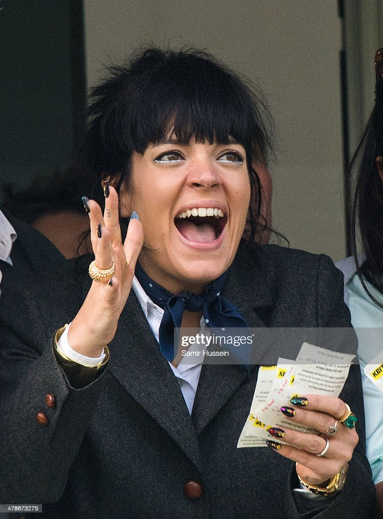 <a gi-track='captionPersonalityLinkClicked' href=/galleries/search?phrase=Lily+Allen&family=editorial&specificpeople=724899 ng-click='$event.stopPropagation()'>Lily Allen</a> watches the Gold Cup race during The Cheltenham Festival at Cheltenham Racecourse on March 14, 2014 in Cheltenham, England.