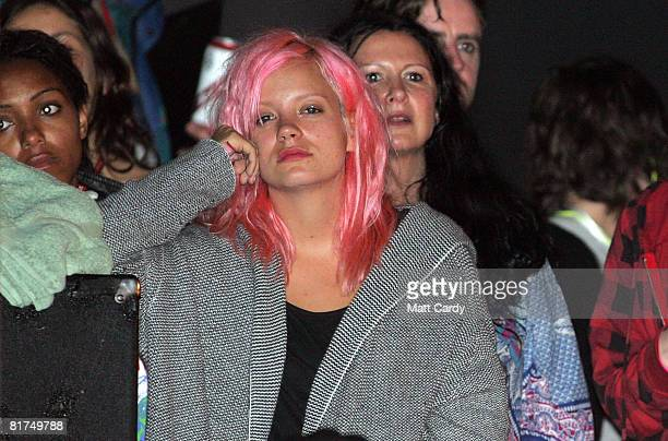 Lily Allen watches The Kills play on the John Peel Stage at the Glastonbury Festival on June 27 2008 in Glastonbury Somerset England The threeday...
