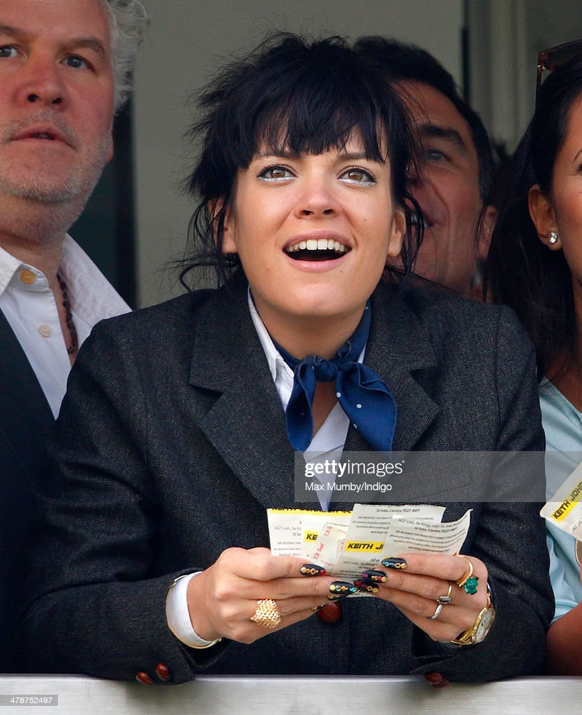 <a gi-track='captionPersonalityLinkClicked' href=/galleries/search?phrase=Lily+Allen&family=editorial&specificpeople=724899 ng-click='$event.stopPropagation()'>Lily Allen</a> watches the racing as she attends Day 4 of the Cheltenham Festival at Cheltenham Racecourse on March 14, 2014 in Cheltenham, England.