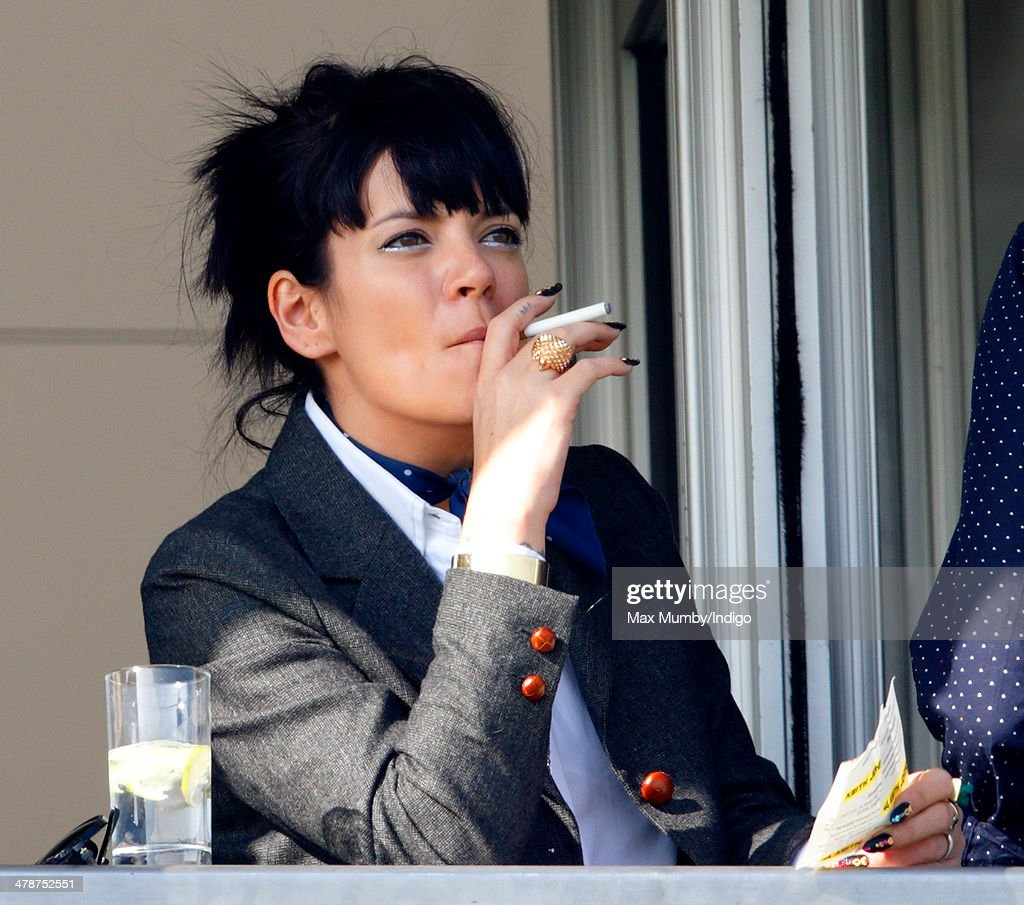 Lily Allen watches the racing as she attends Day 4 of the Cheltenham Festival at Cheltenham Racecourse on March 14, 2014 in Cheltenham, England.