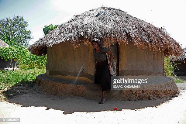 Lily Atong wife of Lord's Resistance Army chief Joseph Kony and sister of Dominic Ongwen gets out of her home during an interview with AFP about her...