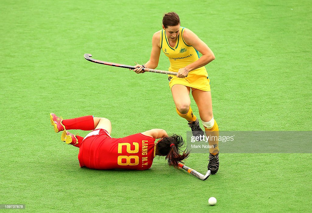 Lily Brazil of Australia collides with Meiyu Liang of China in the Women's Hockey Final between Australia and China at Sydney Olympic Park Hockey Centre on January 20, 2013 in Sydney, Australia.