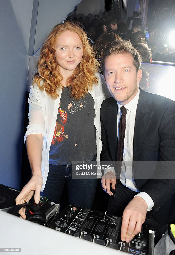 <a gi-track='captionPersonalityLinkClicked' href=/galleries/search?phrase=Lily+Cole&family=editorial&specificpeople=206320 ng-click='$event.stopPropagation()'>Lily Cole</a> (L) and Robin Scott-Lawson DJ at the John Frieda party celebrating 25 years of transforming women's hair at Claridges Hotel on October 29, 2013 in London, England.