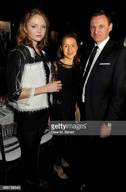 Lily Cole Eugenie Kamasa and Zygi Kamasa attend the Charles Finch and Chanel PreBAFTA cocktail party and dinner at Annabel's on February 8 2013 in...