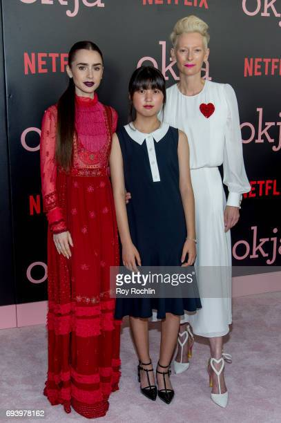 Lily Collins Ahn Seohyun Tilda Swinton and Lily Collins attend the New York premiere of 'Okja' at AMC Lincoln Square Theater on June 8 2017 in New...