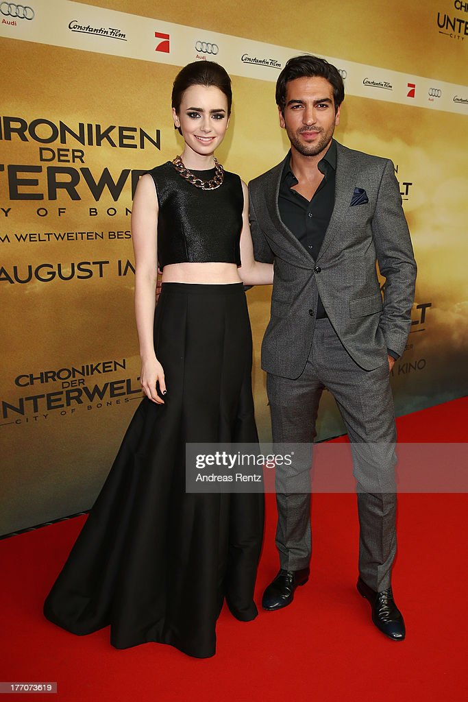 <a gi-track='captionPersonalityLinkClicked' href=/galleries/search?phrase=Lily+Collins&family=editorial&specificpeople=3520243 ng-click='$event.stopPropagation()'>Lily Collins</a> and <a gi-track='captionPersonalityLinkClicked' href=/galleries/search?phrase=Elyas+M%27Barek&family=editorial&specificpeople=3967406 ng-click='$event.stopPropagation()'>Elyas M'Barek</a> arrive for the 'The Mortal Instruments: City of Bones' (Chroniken der Unterwelt) Germany premiere at Sony Centre on August 20, 2013 in Berlin, Germany.