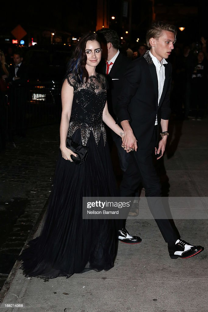 Lily Collins and Jamie Campbell Bower attend the 'PUNK: Chaos To Couture' Costume Institute Gala after party at The Standard hotel on May 6, 2013 in New York City.