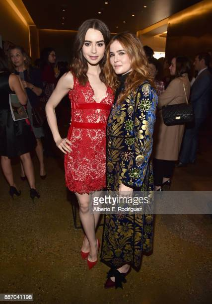 Lily Collins and Zoey Deutch attend The Hollywood Reporter's 2017 Women In Entertainment Breakfast at Milk Studios on December 6 2017 in Los Angeles...