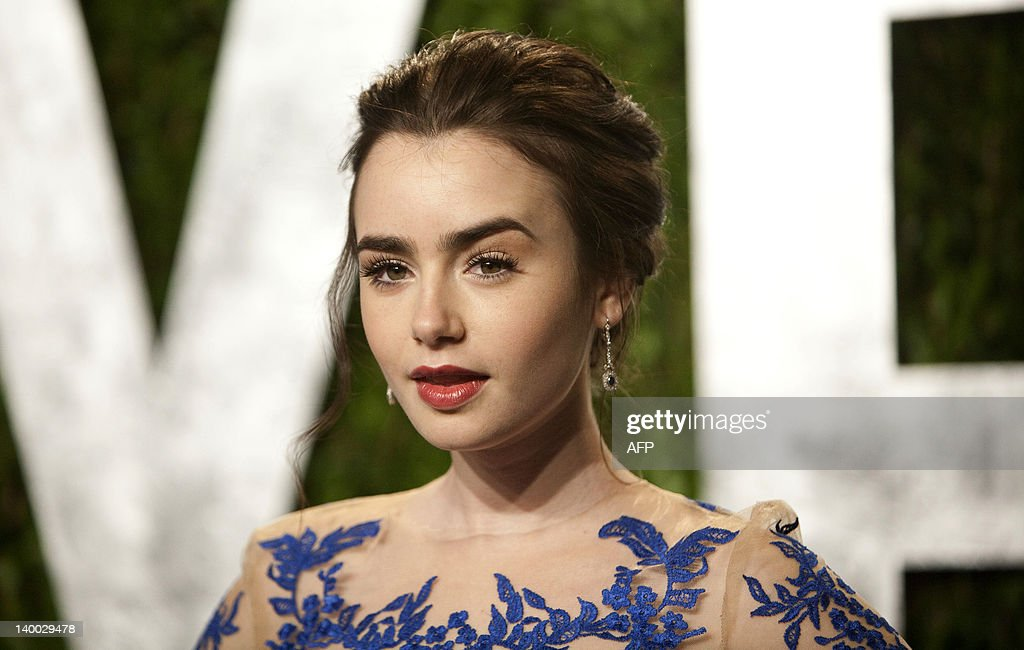 Lily Collins arrives at the Vanity Fair Oscar Party, for the 84th Annual Academy Awards, at the Sunset Tower on February 26, 2012 in West Hollywood, California.