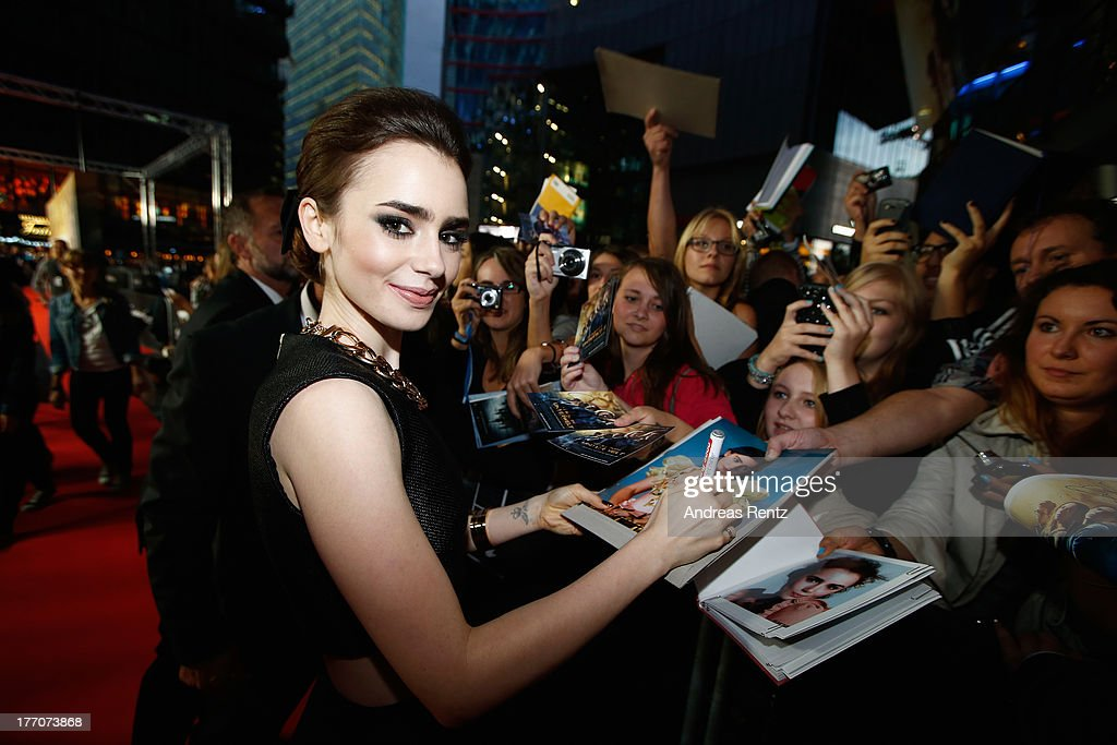 Lily Collins arrives for the 'The Mortal Instruments: City of Bones' (Chroniken der Unterwelt) Germany premiere at Sony Centre on August 20, 2013 in Berlin, Germany.