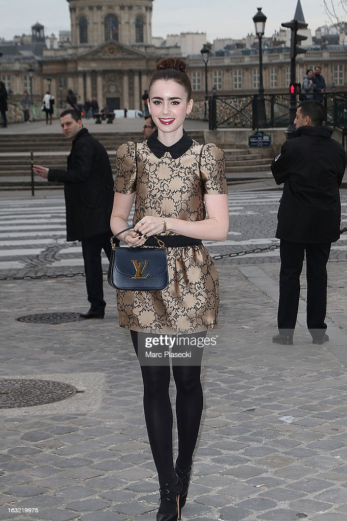 Lily Collins arrives to attend the 'Louis Vuitton' Fall/Winter 2013 Ready-to-Wear show as part of Paris Fashion Week on March 6, 2013 in Paris, France.