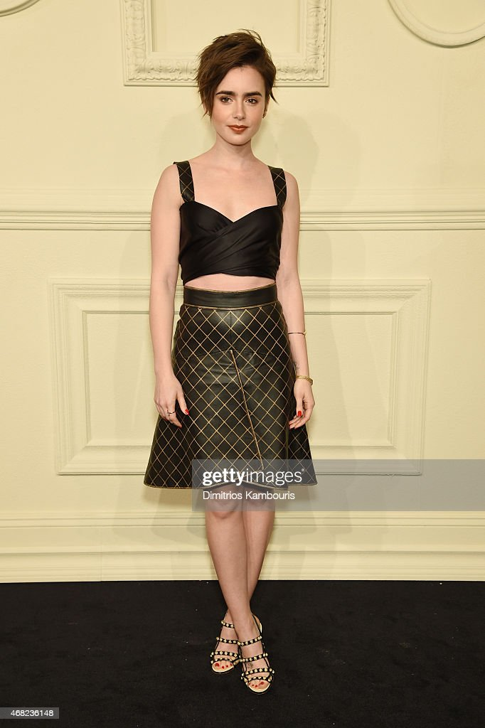 Lily Collins attends the CHANEL ParisSalzburg 2014/15 Metiers d'Art Collection at Park Avenue Armory on March 31 2015 in New York City