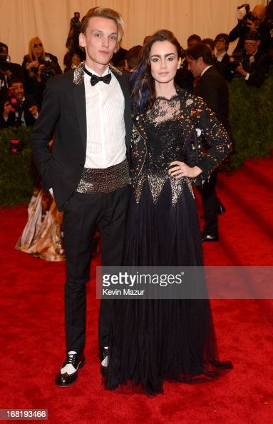 Lily Collins attends the Costume Institute Gala for the 'PUNK Chaos to Couture' exhibition at the Metropolitan Museum of Art on May 6 2013 in New...