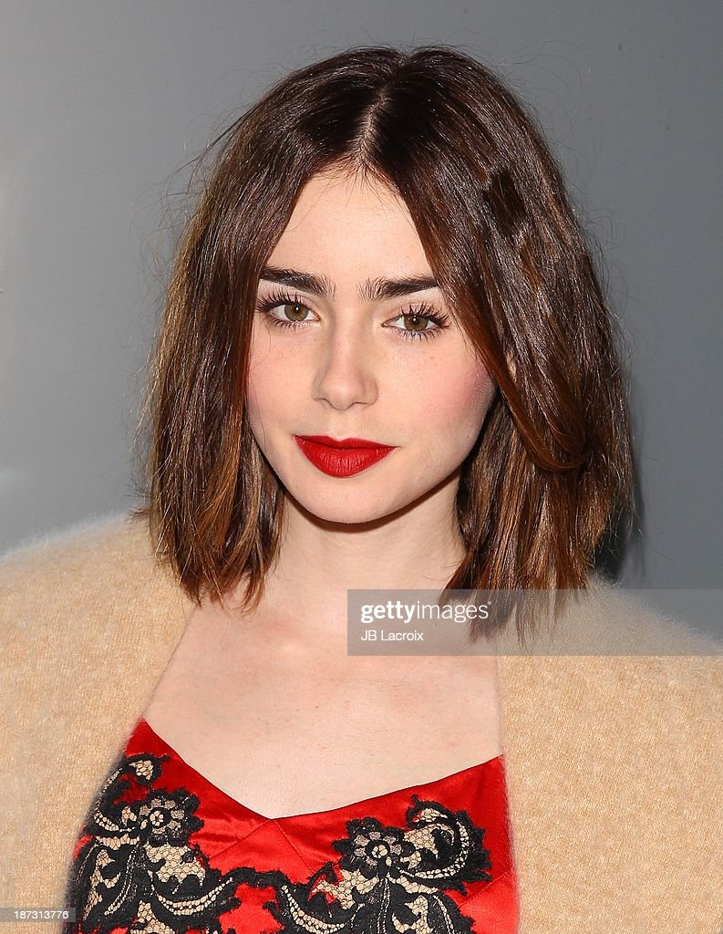 Lily Collins attends the Flaunt Magazine Issue Party with Selena Gomez And Amanda De Cadenet held at Hakkasan Beverly Hills on November 7, 2013 in Beverly Hills, California.