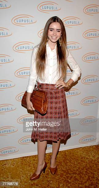 Lily Collins attends the 'Hollywood Bag Ladies' Lupus Luncheon hosted by Marla Maples and chaired by Sharon Stone at the Beverly Wilshire Four...