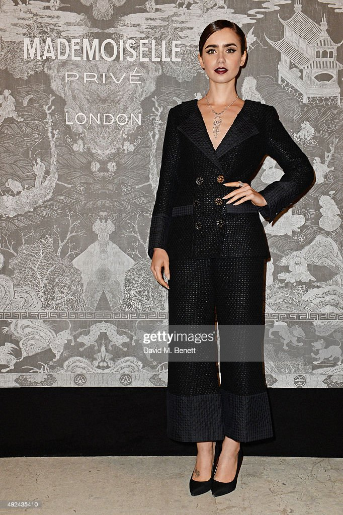 Lily Collins attends the Mademoiselle Prive Exhibition at the Saatchi Gallery on October 12, 2015 in London, England.