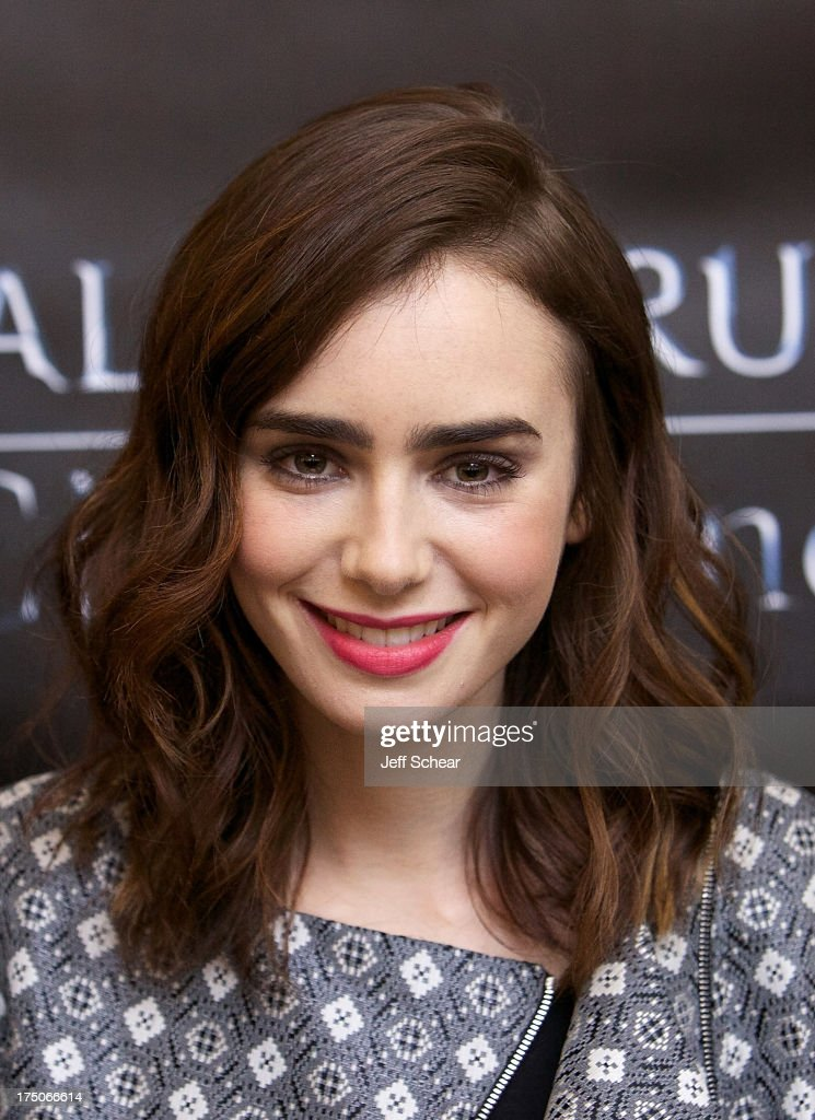 <a gi-track='captionPersonalityLinkClicked' href=/galleries/search?phrase=Lily+Collins&family=editorial&specificpeople=3520243 ng-click='$event.stopPropagation()'>Lily Collins</a> attends 'The Mortal Instruments: City of Bones' mall tour stop at Chicago Ridge Mall on July 30, 2013 in Chicago Ridge, Illinois.