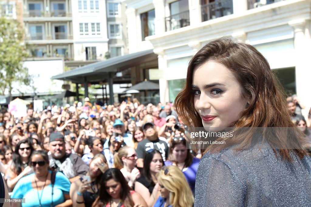 <a gi-track='captionPersonalityLinkClicked' href=/galleries/search?phrase=Lily+Collins&family=editorial&specificpeople=3520243 ng-click='$event.stopPropagation()'>Lily Collins</a> attends the 'The Mortal Instruments: City Of Bones' meet and greet at The Americana at Brand on August 13, 2013 in Glendale, California.