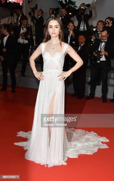 Lily Collins departs from the 'Okja' screening during the 70th annual Cannes Film Festival at Palais des Festivals on May 19 2017 in Cannes France