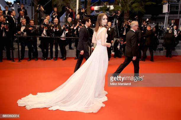 Lily Collins departs the 'Okja' premiere during the 70th annual Cannes Film Festival at Palais des Festivals on May 19 2017 in Cannes France