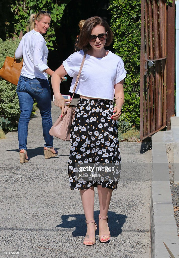 <a gi-track='captionPersonalityLinkClicked' href=/galleries/search?phrase=Lily+Collins&family=editorial&specificpeople=3520243 ng-click='$event.stopPropagation()'>Lily Collins</a> is seen in Hollywood on July 03, 2014 in Los Angeles, California.